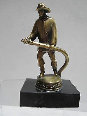 Fireman firefighter with hose statue classic vintage brass made in USA
