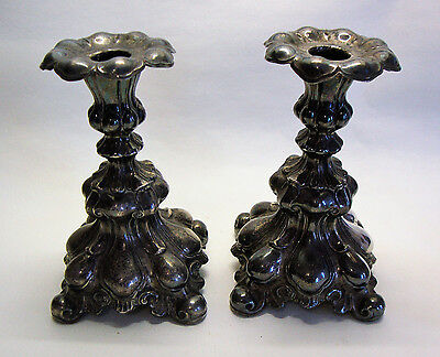 Antique pair of rococo style silver plated candlesticks
