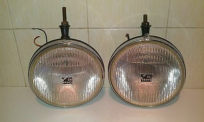 A Pair of Round LUCAS H3 FT/LR 19 Lamps