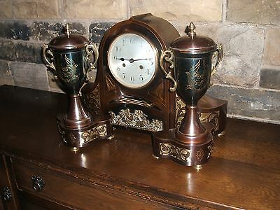 Brown Metal Mantle Clock With Garnitures- Embossed With Brass