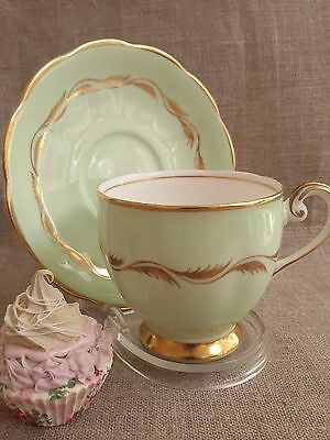Vintage Queen Anne Footed Tea Cup and Saucer. Pistachio Green and Gold. Lovely!