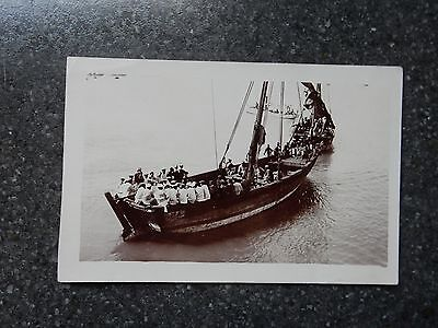 Early real photo postcard - Royal Navy officers on local boat - Suez