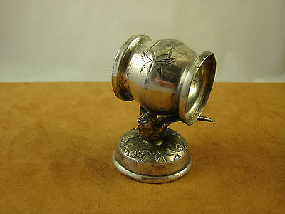 Silver plate figural napkin ring with ring balanced on outspread wings of bird