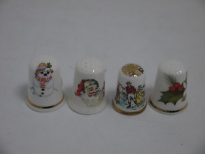 Four china thimbles of Christmas   (HEB03)