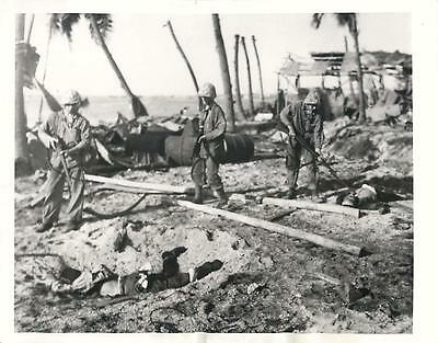 WWII U.S. 4th Division Marines Check Japanese Dead at Roi Airfield Press Photo