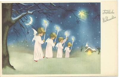 Four Christmas angels  carry torches towards church