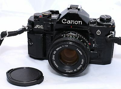 Canon A-1 35mm SLR Film Camera with 50mm f/1.8 Lens and Original Manual