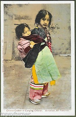 Young Chinese Girl Carrying Baby. San Francisco Chinatown c1902.