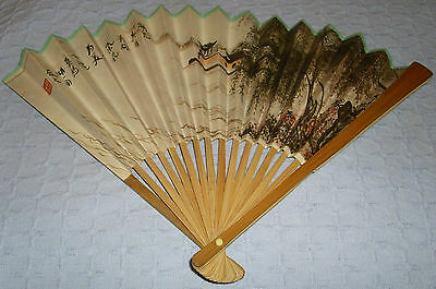 Bamboo and Paper Fan with landscape in very good condition.