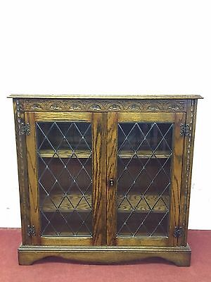 Carved Oak Glazed Bookcase