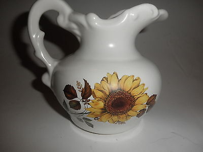 small decorative  flowered pitcher 5 inches tall