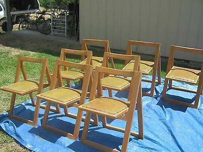 A Set of 8 Retro 70's Collapsible Stackable Curved Backrest Timber Dining Chairs