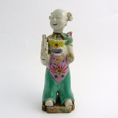 Chinese Famille Rose Porcelain Figure Of A Boy Holding A Flower, Jaiqing Period