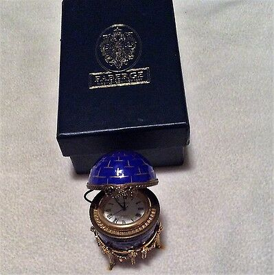 Faberge egg by Limoges--blue decorative egg with removeable clock inside.