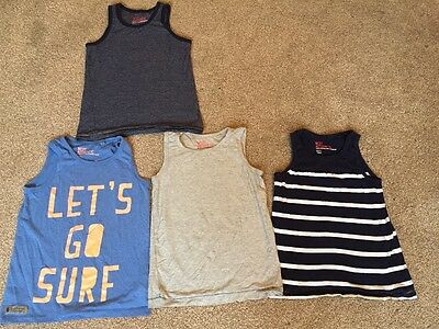 Next boys bundle of 4 vest tops for summer/ holidays age 7 years!!