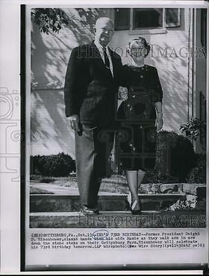 1963 Wire Photo President Eisenhower, clasps hands with his wife Mamie.