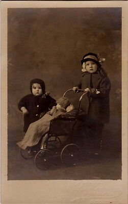 Edwardian Children  With Pram And Doll