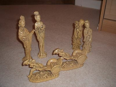 a collection of ivory effect figures