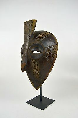 Abstract Bembe African mask on display stand, African Art