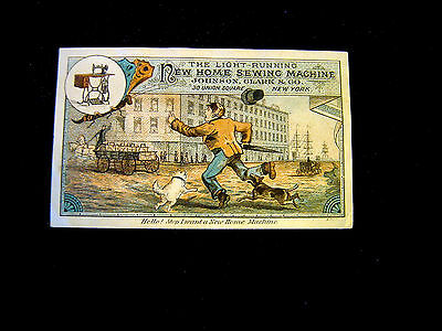 Victorian trade Card=Man-Pet Dogs chase WAGON full of NEW HOME SEWING MACHINES