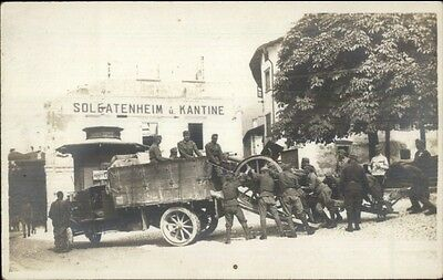 WWI Loading Cannon onto Truck Soldatenheim Kantine Real Photo Postcard dcn