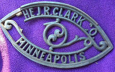 ANTIQUE The J. R. Clark Co. Minneapolis Sad Iron Trivet Cast Iron 1930's