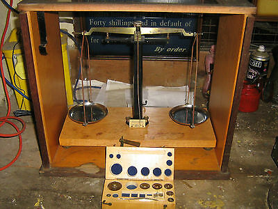Set of cased laboratory scales by Philip Harris & Co