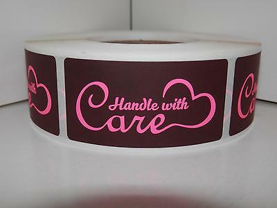 HANDLE WITH CARE 1x2 fluor pink letters black background Sticker Label 500/rl