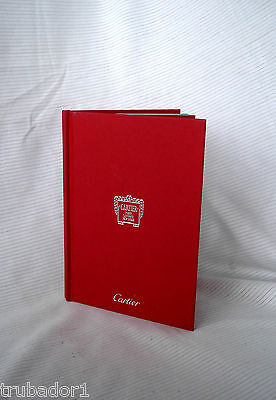 Cartier Book Hardbound, 68 pages, lovely photos of gorgeous jewelry, French text