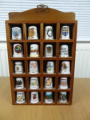 20 China Thimbles in a Wooden Wall Hanging display