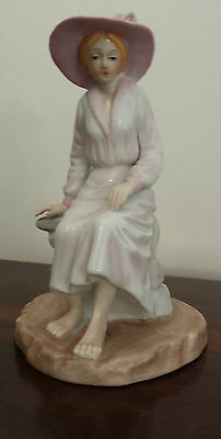 Porcelain Seated Barefoot Lady Figurine