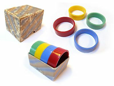 "Boxed Vintage 1950s Multi coloured 4 PLASTIC 1½"" NAPKIN RINGS RED BLUE GRN YELO"