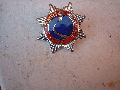 bournemouth international airport fire service  cap badge    OBSOLETE