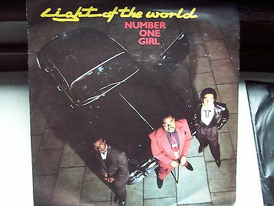 Light Of The World, Number One Girl / Check Us Out.  Original 1982 Emi Single