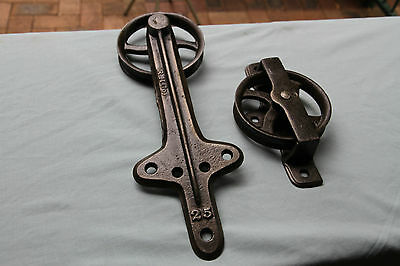 Antique Cast Iron Wall Mounted Pulleys. Very nice old tools.