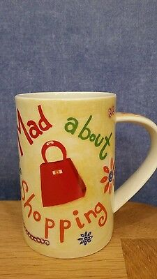"""DUNOON """"Mad about  Shopping  Mug Designed by Jane Heyes"""