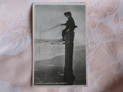 Old B&w Photo Pc Young Boy Sitting On Top Post Fishing, Walcheren, Netherlands