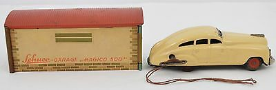 Gorgeous Schuco Patent 1750 wind up car with Magico 500 garage Germany tin