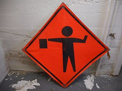 """Flagger Symbol 36"""" X 36"""" Reflective Roll Up Sign With Ribs."""