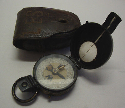 Early 20th century leather cased marching compass marked H.H.V