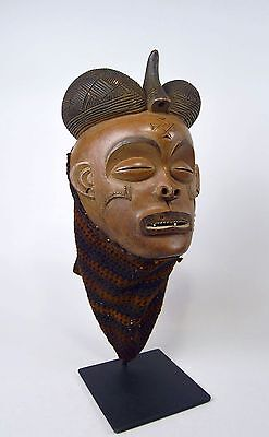 A Fine Chokwe Mwana Pwo African mask on display stand, African Art