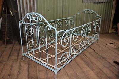 An Antique Ornate French Provincial Wrought Iron Childs Bed - Foldable