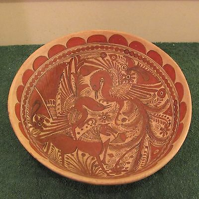 Vintage handmade bowl with painted design
