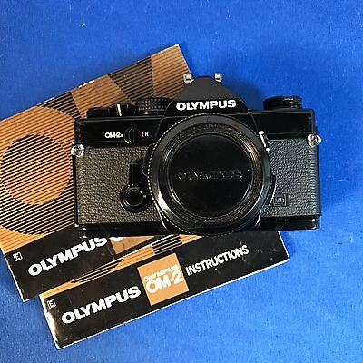 Olympus OM2n Black Body SLR 35MM Camera tested and working VGD+