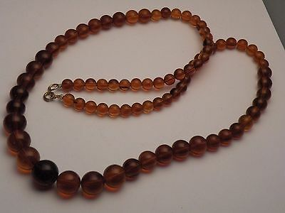 "kvsC RECONSTITUTED AMBER BEAD NECKLACE, 30"" LONG beads 15mm to 8mm"