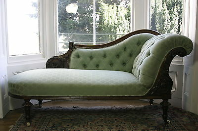 19th C Mahogany Chaise Longue with carved detailing and raised on reeded legs