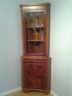Traditional style yew wood astragal glazed corner cabinet on cupboard