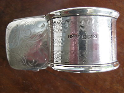 Solid silver napkin ring,and silver pill box.