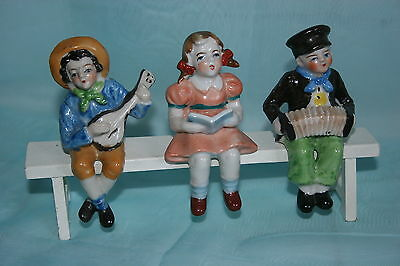 Occupied Japan china Figural scene - 3 children sitting on bench playing music