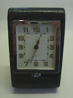 Mid 20th century JAEGER-LECOULTRE traveling alarm clock in leather covered case
